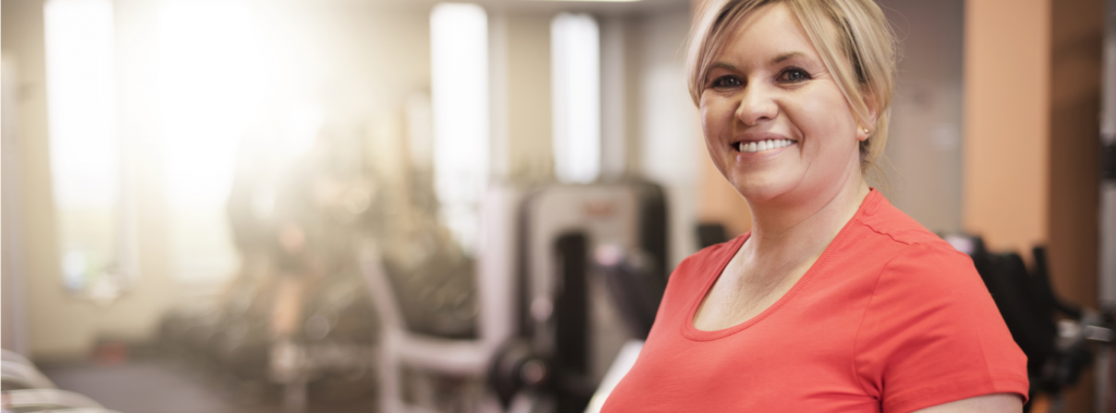 Lady in gym as part of weight loss program with The BMI Clinic