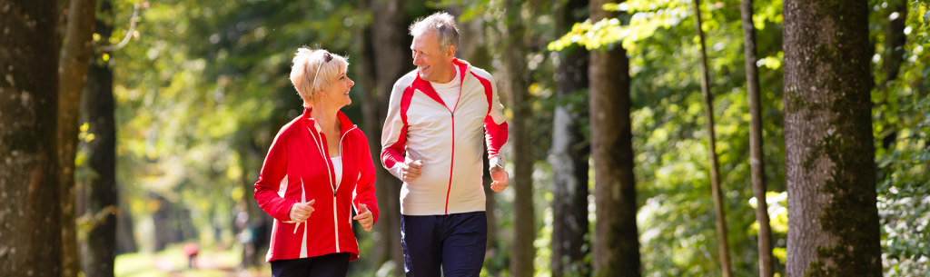 couple jogging outdoors as part of aftercare program for weight loss